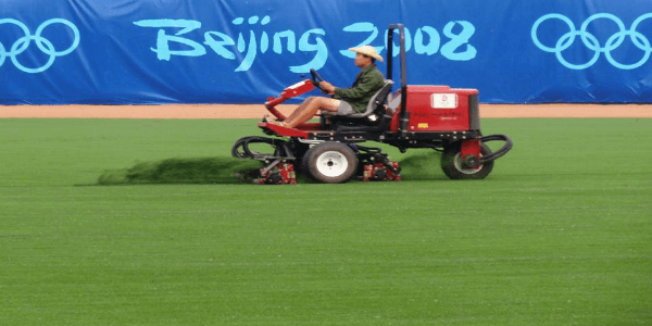 a man mowing riviera grass at the beijing olympics